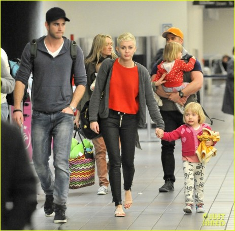 Miley Cyrus Liam Hemsworth Take Flight With The Family Body