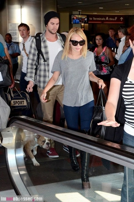 Miley Cyrus And Liam Hemsworth Touch Down In Philly And Liam Hemsworth
